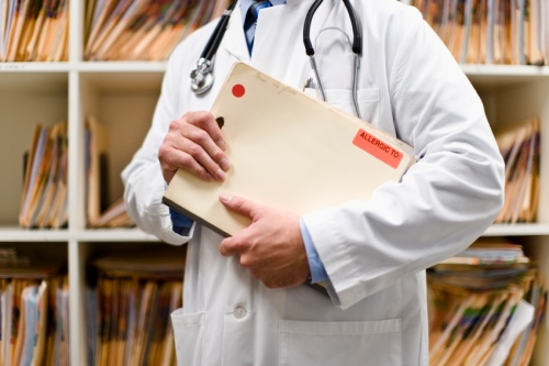 Doctor in Medical Record's room.