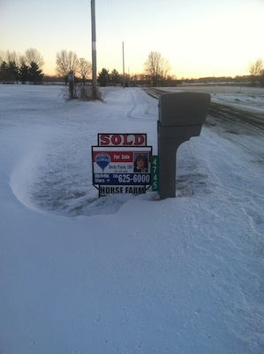 snowy sold sign
